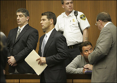 Defendants James Brescia (left) and Scott Foxworth (second from right) appeared in a Cambridge court with their lawyers, Eugene Patrick McCann (far right) and Joseph P. Cataldo.