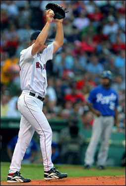 Red Sox starting pitcher Tim Wakefield stretched his back out on the mound, as the Royals' Emil Brown stood at third base in the second inning. Wakefield struggled in the second, giving up three runs.