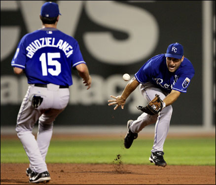 Royals shortstop Tony Graffanino scooped the ball with his glove and shuffled it to second baseman Mark Grudzielanek to force out Coco Crisp on a Doug Mirabelli grounder in the fifth inning.
