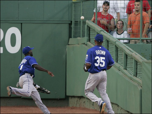 Kansas City Royals center fielder Joey Gathright and right fielder Emil Brown (35) watched as the ground rule double by Coco Crisp bounced into the stands in the second inning.