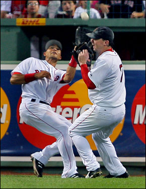 Red Sox center fielder Coco Crisp (left) and right fielder Trot Nixon (right) collided as Crisp hauled in a fifth-inning fly ball of the bat of the Royals' Emil Brown.