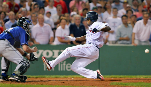 Red Sox pinch runner Willie Harris arrived at the plate a split second before the ball as he scored what would turn out to be the game-winning run on Manny Ramirez's eighth-inning sacrifice fly.
