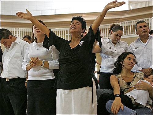 Miriam Vargas, the mother of Milena Del Valle, at funeral services for her daughter at the Oasis de la Esperanza evangelical church in San Jose, Costa Rica. Milena Del Valle was killed on July 10, 2006 when a slab of concrete from a Big Dig tunnel fell on top of a car in which she was a passenger. Her husband, Angel Del Valle (right), survived the accident.