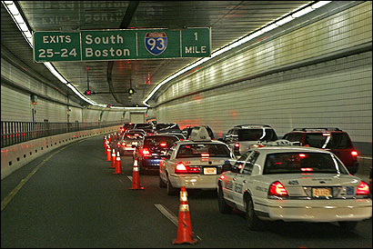 Traffic crawled through the Ted Williams Tunnel going westbound from Logan Airport.