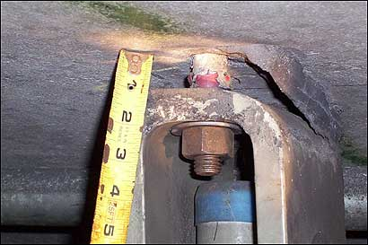 A ruler measured the apparent separation of one of the bolts from the roof in the eastbound Ted Williams Tunnel.