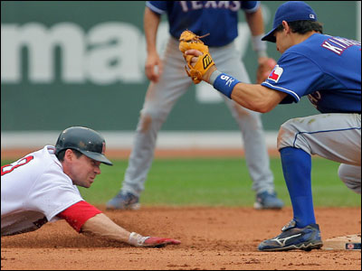 Rangers second baseman Ian Kinsler prepares to apply the tag to Mark Loretta, who was picked off to end the sixth inning.