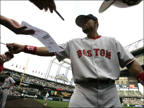 Red Sox center fielder Coco Crisp signed autographs before the opening game of a three-game set in Seattle.