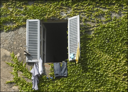 Laundry dries in the sun while hanging outside a window of the main house at Spannocchia.