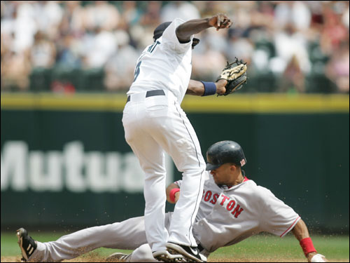 Coco Crisp stole second as Mariners shortstop Yuniesky Betancourt turned to attempt a tag during the second inning.