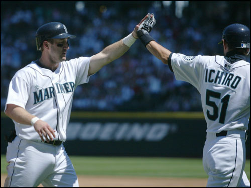 Willie Bloomquist, left, and Ichiro Suzuki celebrated at home after scoring on a double by Adrian Beltre during the first inning.