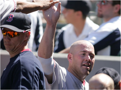 Kevin Youkilis was congratulated in the dugout after scoring on a single by David Ortiz in the sixth inning.
