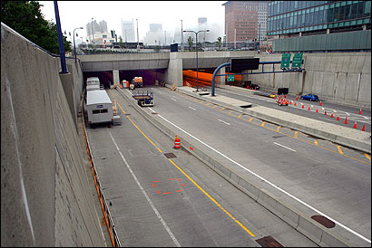 No construction workers could be seen yesterday at the mouth of the Interstate 90 connector eastbound (left), but officials said engineers were working in the roof.