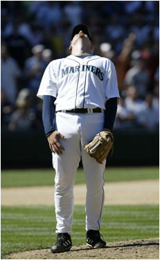 Mariners pitcher J.J. Putz reacted after giving up Varitek's home run.