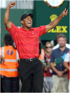 Tiger Woods rejoiced after his final putt to win the British Open.