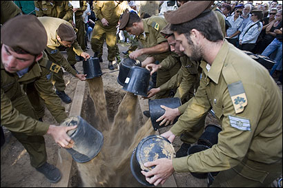 Family, friends, and fellow soldiers buried Sergei Volsiuk n Kibbutz Lahav, Israel. Volsiuk, 21, was killed Thursday by a Hezbollah rocket-propelled grenade in southern Lebanon.