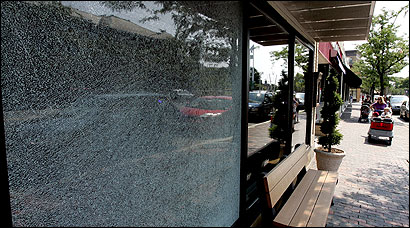 A shattered pane of glass in front of Tryst restaurant in Arlington Center.