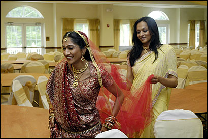 Bride Shveta Sinha and sister Charita (right) make their way to an Indian/Jewish wedding ceremony at the Hudson Portuguese Club.