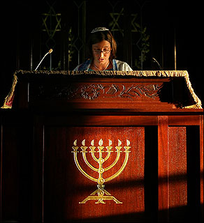 Jeanette Macht recites prayers during a rehearsal for her bat mitzvah at Temple Shir Tikvah in Winchester.