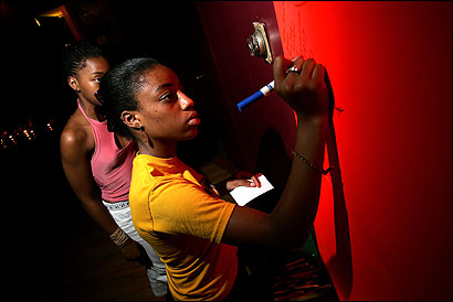 Kimberlee Smith, 15, of Dorchester, wrote during a night when 50 community activists shared support.