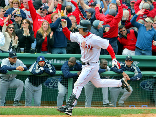 The winners of the 2006 Boston Marathon crossed the finish line minutes before Mark Loretta's two-run blast sent Red Sox fans home happy on Patriots Day.