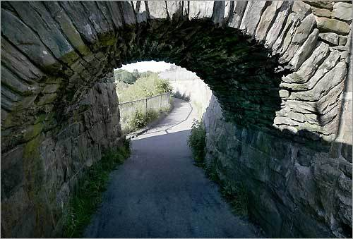 A stone archway in the beginning of the restored Cliff Walk.