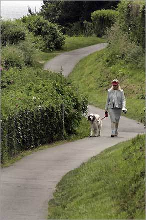 Kathy Managhan of Jamestown, R.I., and her English setter, Lily, stroll along the Cliff Walk.