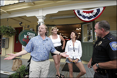 George Cleveland (left), chatted with Lisa Barron, her sister Linda Mullins, and Police Chief Daniel Porter outside The Olde Village Store in Tamworth, N.H.