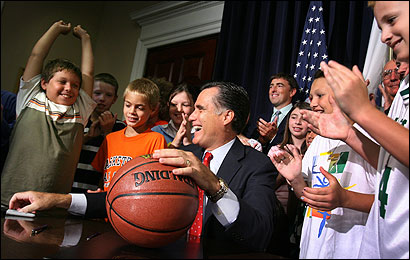 Billy Alberts, 10, (left), celebrated with Governor Romney yesterday at the State House.
