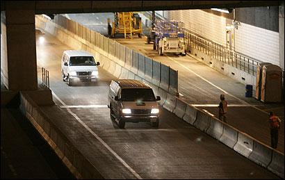 Traffic passed near the location of the fatal tunnel ceiling collapse in South Boston early this morning.