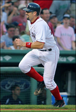 At least part of the blame can be attributed to a rash of untimely injuries. The captain, Varitek, seen here grimacing in pain, injured his right knee on July 31 and was subsequently placed on the disabled list. Varitek's loss leaves a big hole behind the plate.