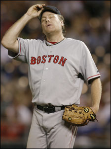 An exasperated Curt Schilling takes a deep breath after walking Emil Brown during his disastrous eighth inning.