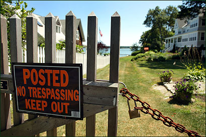 A locked gate blocked access from Melville Walk to the beach in the Crow Point section of Hingham.