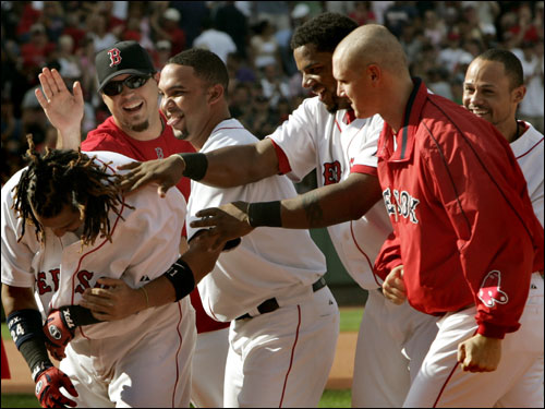 With his 26-game hitting streak on the line, Manny Ramirez won the game in the 10th inning with a single that scored Gape Kapler with the winning run.