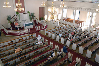 The spirit of parishioners at Old West Church in Boston was stronger yesterday after the pulpit Bible was desecrated and paintings were damaged. At the Sunday service, they prayed for themselves and the vandals.