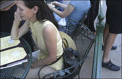 At Stephanie's on Newbury Street, Monica Shuler kept her handbag right beside her.