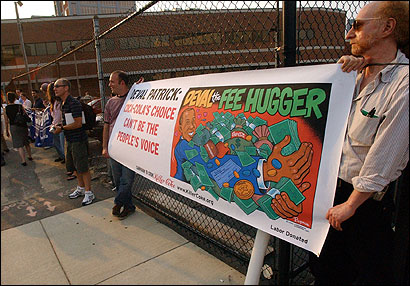 Demonstrators held a banner protesting Deval L. Patrick's connection to Coca-Cola at a Patrick fund-raiser in Boston on Thursday. From 2001 to 2004, Patrick was the general counsel responsible for global legal affairs for Coca-Cola.