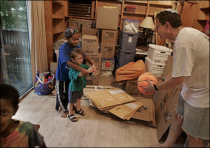 Yosef Abramowitz played ball with three of his children yesterday, in the midst of preparing for the the family's move to Israel.