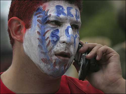 Larry Trust of Medway looked a little too serious for his face paint as he talked on the phone before entering Fenway Park.