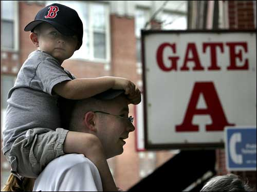 Three-year-old Jacob Davis of West Lebanon, NH, looked down as he headed into the game with his dad.