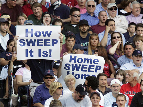 Yankees fans at Fenway Park hold up signs foretelling a five-game sweep.