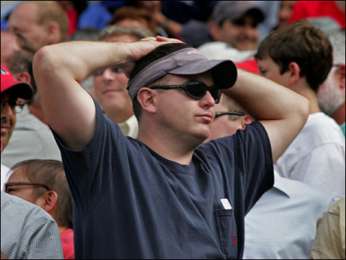 Mike Saunders of Walpole, a lifelong Red Sox fan, reacted after the final out of the game.