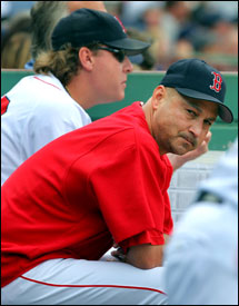 Terry Francona (front) and Curt Schilling don't appear too happy as the Yankees near completion of their sweep.