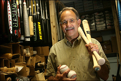 UMass-Lowell mechanical engineering professor Jim Sherwood in the bat closet at the university's Baseball Research Center.