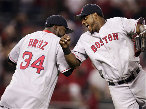 David Ortiz, left, and Wily Mo Pena celebrated a losing-streak-snapping 5-4 win over the Angels.