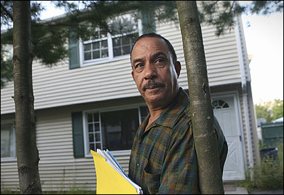 Jose Felipe stood Thursday in front of the Lawrence duplex he says was bought by a mortgage consultant who used his name and Social Security number.