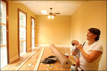 Jennifer Weishaupt and her 3-month-old son, Aidan, checked on the progress of the house she and her husband bought on Telemachus Street. They are in the process of renovating the home damaged by Hurricane Katrina.