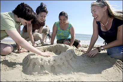 Speaking only in Latin for their Nantucket visit, teachers Sarah Bjorkman, Sophia Rovitti, Danielle Hui, and Meghan Preston worked on a sand version of the Colosseum last week.