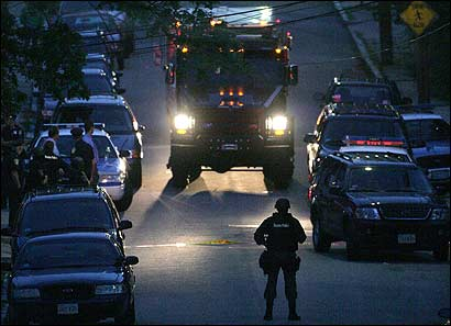 Police surrounded a house on Charles Street in Hyde Park last evening after a 21-year-old man was shot to death on a nearby street. The shooting ended Boston's longest period without a homicide this year -- 30 days.