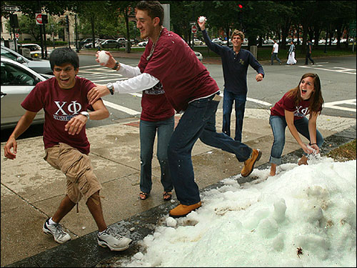 A ton of snow was delivered to the front lawn of MIT Fraternity house Chi Phi on the corner of Commonwealth Ave. and Hereford Street in the Back Bay to welcome students back as they moved in. Atul Kapila (left) was chased by Adam Juneau, both class of MIT '09, while friends prepared to open fire.