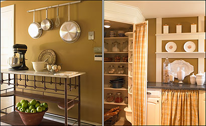 An antique French iron baker's table (left) adds to the Provencal theme and fills a practical as well as aesthetical role. By replacing a wall of cabinets with a simple grid of shelving (right), Paula Daher made the room feel more open. The large corner pantry offers plenty of storage. Plaid taffeta panels dress up the doors and hide an undercounter dishwasher.